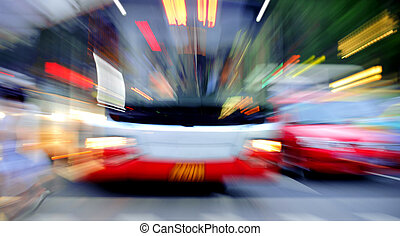 High-speed vehicles blurred trails on urban roads