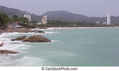 High speed waves tropical turquoise beach with stone at Kata beach Phuket sea  Thailand