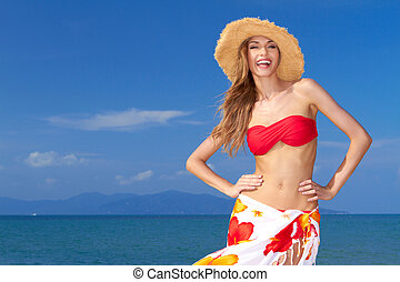 High-spirited beautiful woman laughing in merriment as she...