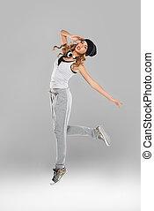 High-spirited young woman dancing