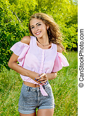 high spirits - Beautiful smiling young woman outdoors. Happy...