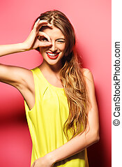 high spirits - Happy emotional young woman in bright yellow...