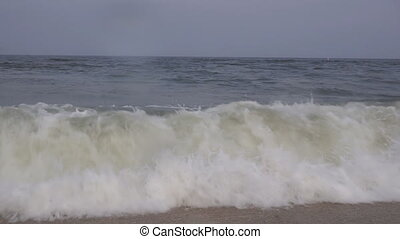 High surf from giant breaking ocean waves driven by high...
