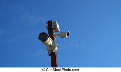 High-tech CCTV camera on a pole.