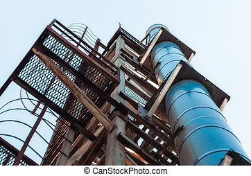 high technical structure with a pipe against the blue sky