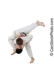 High throw judo are training boys in white kimono