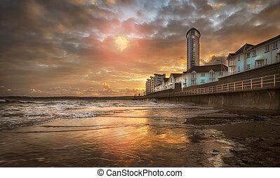 High tide at sunset at Swansea Bay