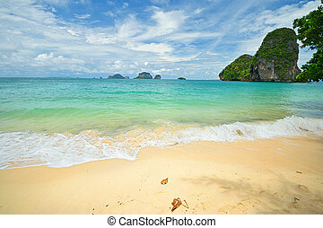 High tide during monsoon season in scenic Railey Bay, Krabi, Southern Thailand.