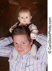High up on daddy\'s neck