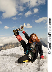 High up - Red haired girl cheering at the top of a high ...