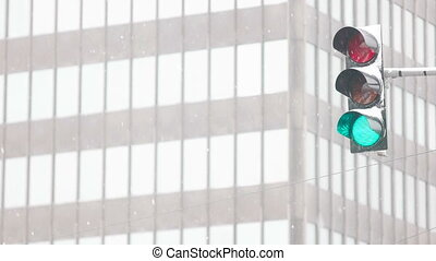 High up Traffic Light - Traffic light shining with green...