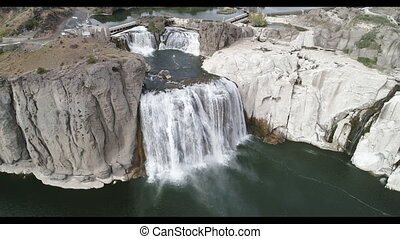 Large waterfall within idaho known as the shoshone falls