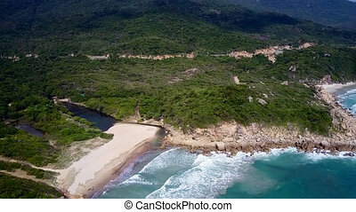 high view green sea coast with beach washed by ocean - high...