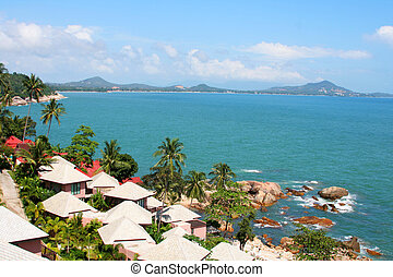 coastline - high view of tropical island coastline with...