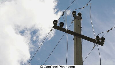 High-voltage electric line outdoors. Close-up - High-voltage...
