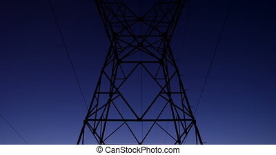 High voltage electric pole during sunset 4K 4k - Low angle ...