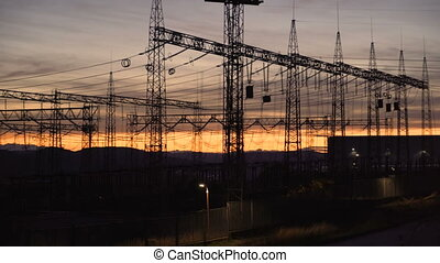 Power lines at sunset. Electricity distribution station at sunset