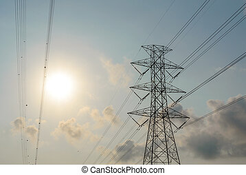 high voltage electrical post and wire under sun cloud sky