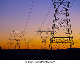 High voltage electricity power lines at sunset