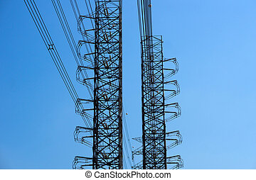 High-voltage of power transmission towers on blue sky background