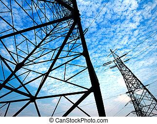 High-voltage pole - Electricity pylon against blue cloudy...