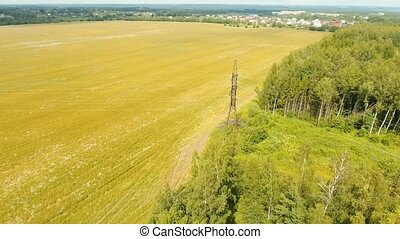 High voltage power line. Aerial view. - Power pylons and...
