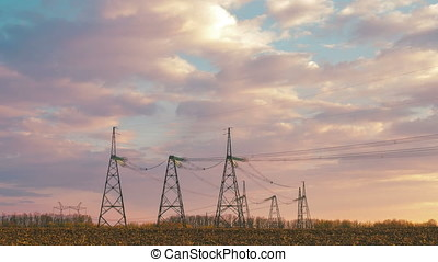 High voltage power line at evening sky