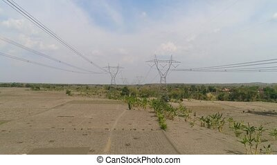 High voltage power line. - Electricity pylons bearing power...