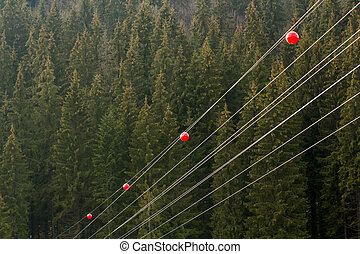 High voltage power line with big ball for warning pilots,...