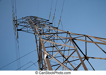 High-voltage power lines against the sky. Industrial...