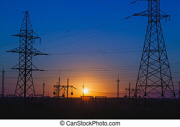 high-voltage power lines at sunset.