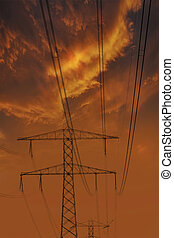 High voltage power lines. Electricity Pylons at Sunset