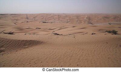 High-voltage power lines in Rub al Khali desert United Arab...