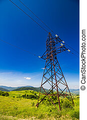 High voltage power lines tower in mountains - High voltage...