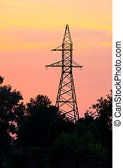 High voltage power tower at sunset