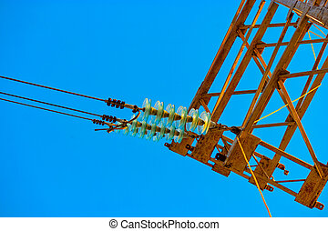 High voltage power tower detail with set of glass electrical insulators