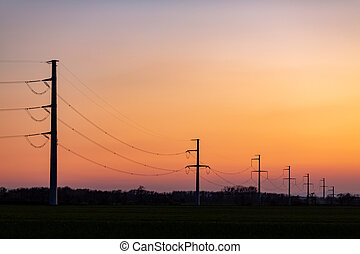 High voltage power tower over sunset clear sky, blackout ...