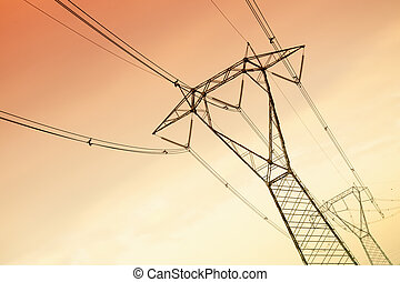 high voltage pylons at sunset. Copy space
