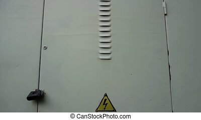 High voltage sign on the door that indicates that beyond that door you can find a place where there is high voltage