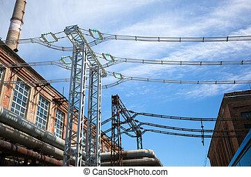 high-voltage substation on blue sky background