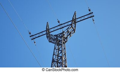 high-voltage tower against a blue sky Electricity technology...