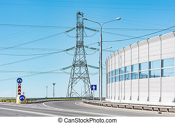 High-voltage tower and noise protection fence.