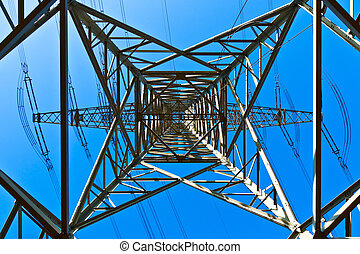 High voltage tower on a background with sky