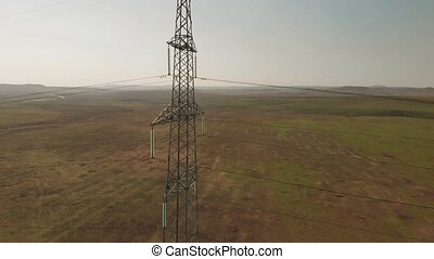 High-voltage tower sky aerial view.