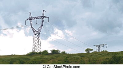 High-voltage tower sky against clouds timelapse