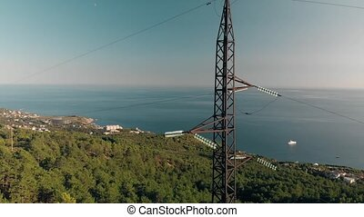 High-voltage tower sky against sea
