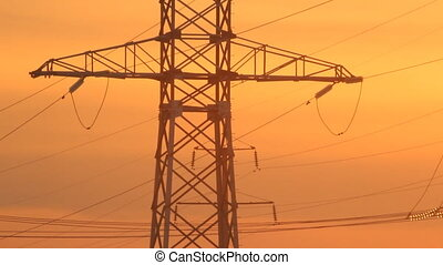 High voltage towers at sunset