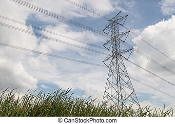 High voltage transmission towers with sky background.