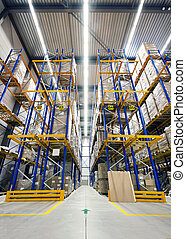 Warehouse with high racks, loaded with boxes, ready to be shipped to customers