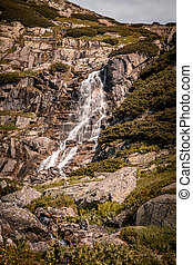 High waterfall on hike in the High Tatra mountains
